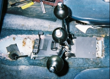 holds the shifter cable in place. Take off the cable mounting bracket